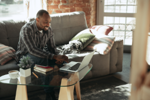 Man Working Using Laptop on Coffee Table